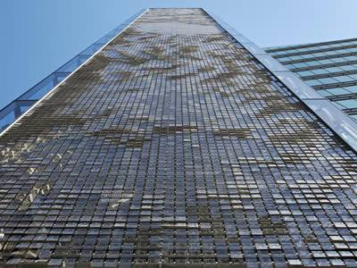 The tall building are covered with perforated kinetic screens.
