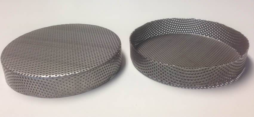 The picture shows front and back of perforated filter bowl with plate shaped bottom.