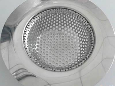 Perforated filter bowl with round and micro holes has wide margin.