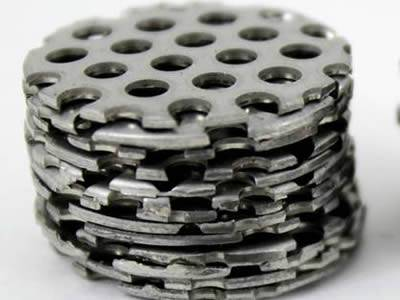Perforated filter disc with unified, round and micro holes without margin.